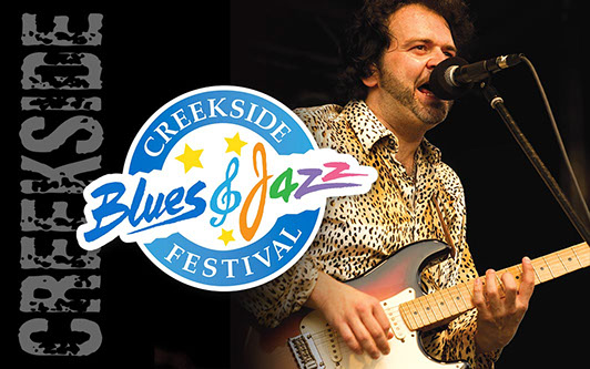 Creekside Blues & Jazz Festival logo placed over photo of performer